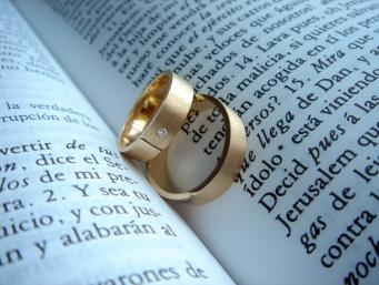 Wedding rings on book
