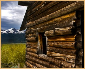 Log cabin with mountains in distance