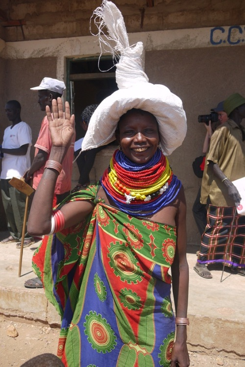Turkana woman carrying food